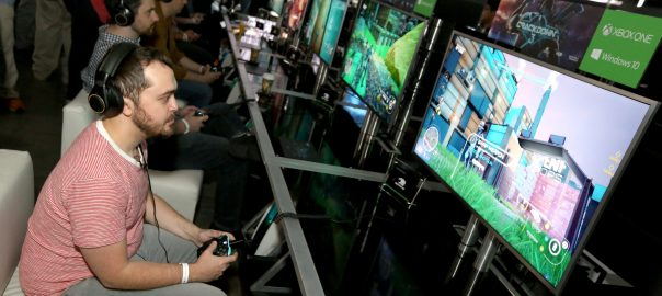 "Gamers play ""Crackdown 3"" at the Xbox Media Showcase at E3 2017 in Los Angeles on Monday, June 12, 2017. (Photo by Casey Rodgers/Invision for Microsoft/AP Images)"